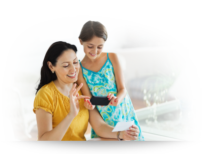 mother and daughter with cell phone and faster money card